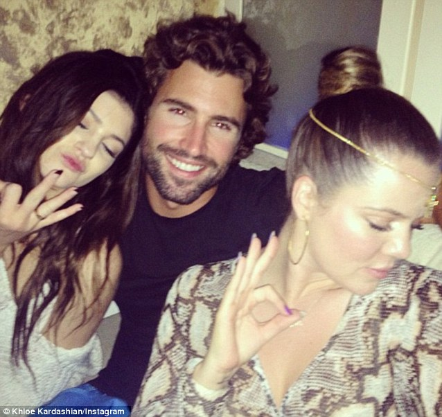 Giving the OK: She posed with her half-siblings Brody and Kylie Jenner