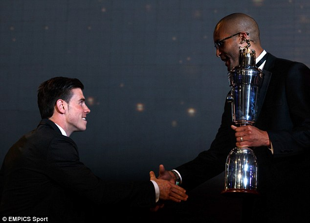 Furious: PFA Chairman Clarke Carlisle, presenting Bale with his award, said he was embarrassed by the event