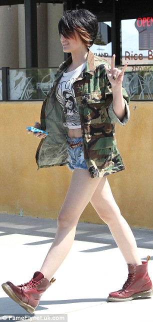 Rock chick: The Jackson child once again showed off her rocky side wearing cut-off shorts with Dr. Marten boots