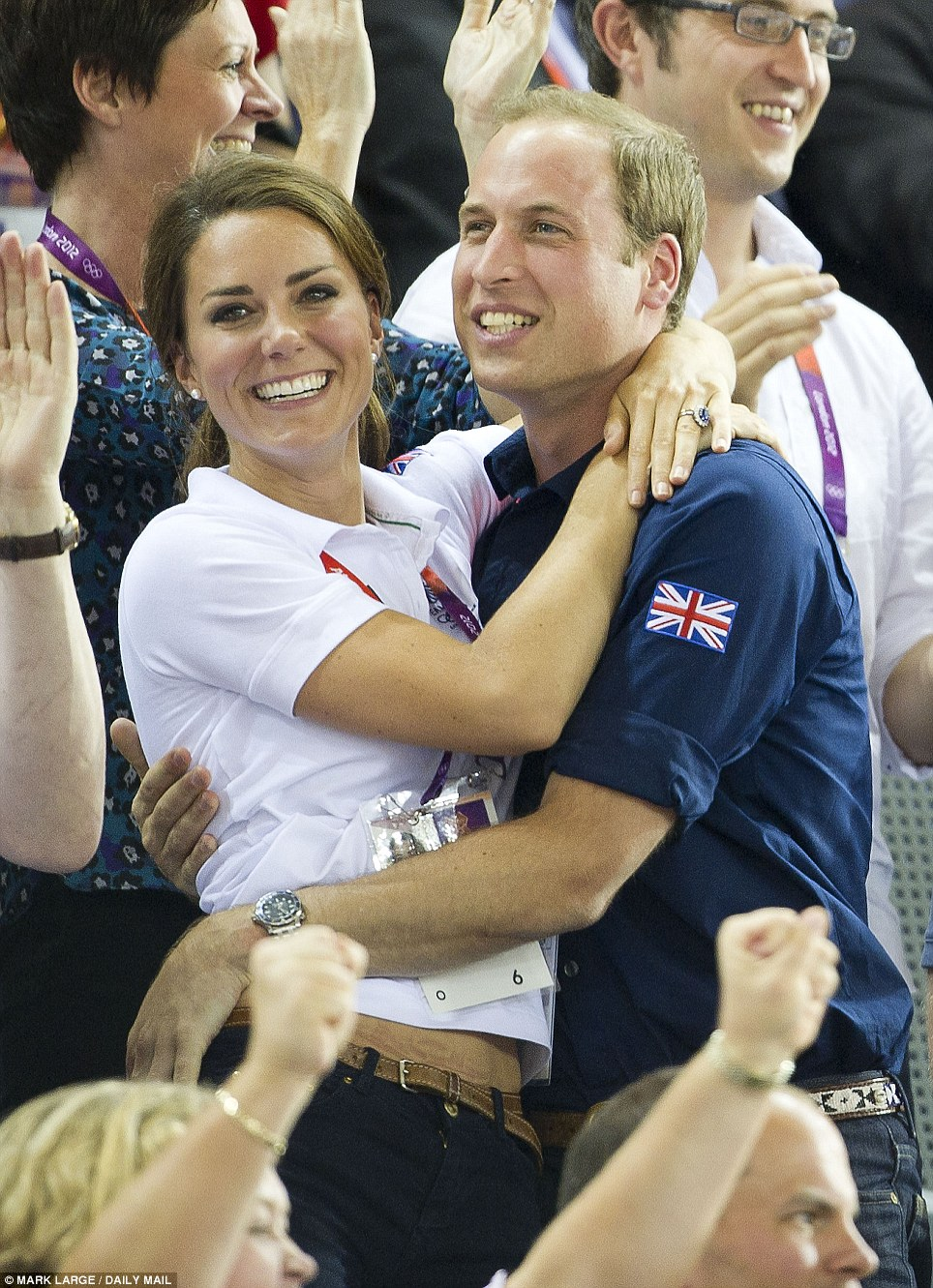 Your Royal hugness! The Royal duo shared a rare public embrace as they cheered Sir Chris Hoy to victory at the Olympic Games in August 2012