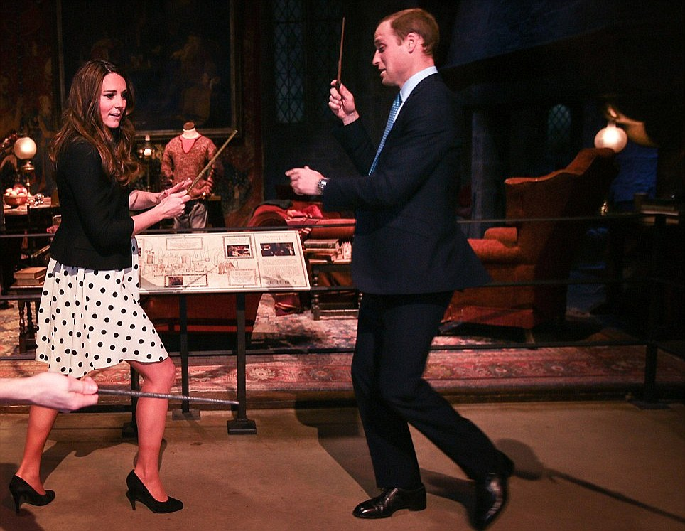 Wizard duel: The Duke and Duchess pretend to battle during their tour of the Harry Potter sets in Hertfordshire in April 2013