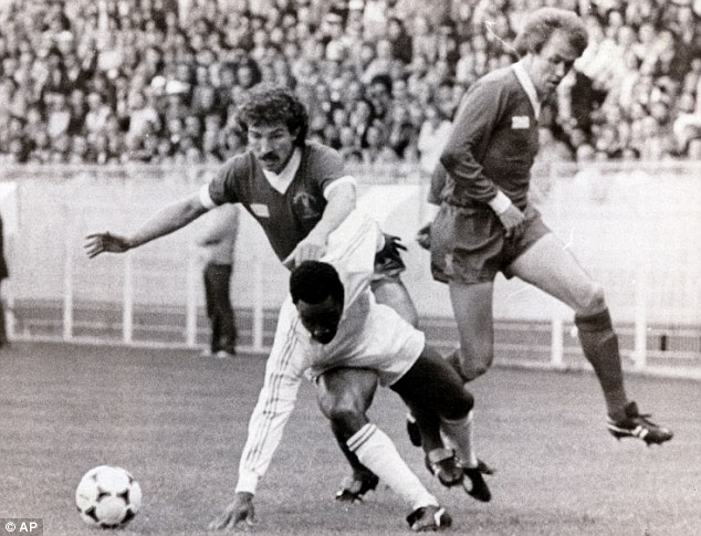 Hard man: Graeme Souness (left), here challenging Real Madrid's Laurie Cunningham in 1981, was central to Liverpool's success in the late 1970s and early 1980s