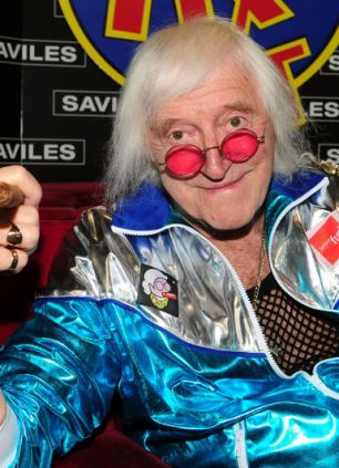 Mr Monk wore a mask of DJ paedophile Jimmy Savile to a Halloween party