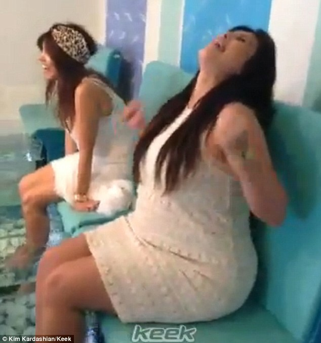 Freaky fish: Kim Kardashian posted a video of her and Kourtney having a fish pedicure in Greece on Wednesday