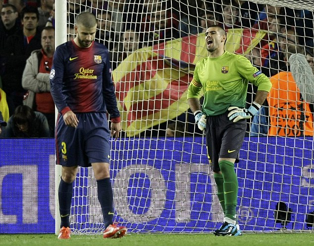 Hang your head: Barca goalkeeper Victor Valdes screams in frustration after Pique's gaffe