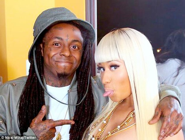 Falling ill: It is understood that Lil Wayne was taken to hospital in March after falling ill on set of Nicki Minaj's music video shoot for High School. They are pictured here filming the video together shortly beforehand