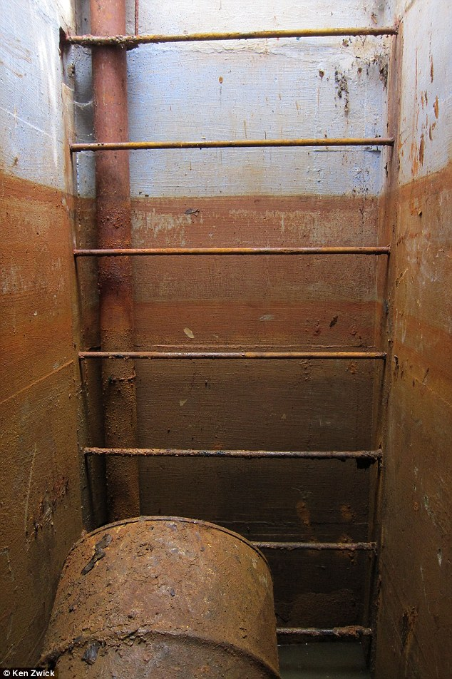 Down, down, town: The muddy ladder leading to the bunker reveals that the underground shelter has endured years of flooding