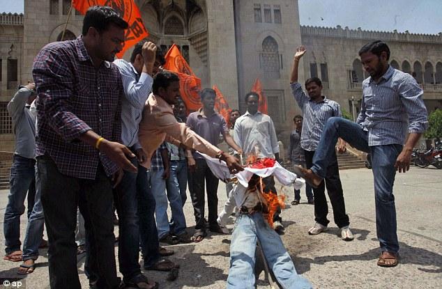 Activists of the right-winged student's organization Akhila Bharatiya Vidya Parishad (ABVP) burn an effigy representing China.