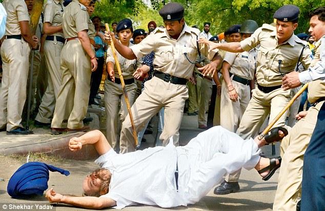 Indian police kuttey beating up elderly sikhs