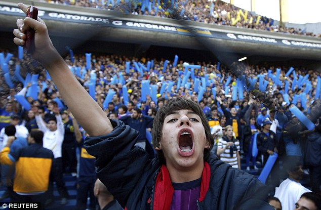 Excitable: A Boca Juniors' fan roars on his team with vigour