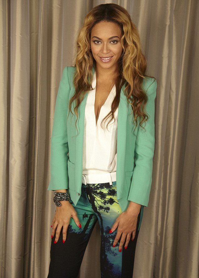 Looking mint: Beyonce looked colourful in a green blazer, white top and printed trousers at a press conference in London on Saturday