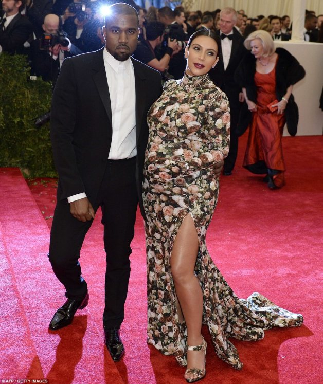 It's a match: Kim Kardashian, who has preciously been banned from the event, wore a floral dress with matching gloves and shoes as she posed up with boyfriend Kanye West