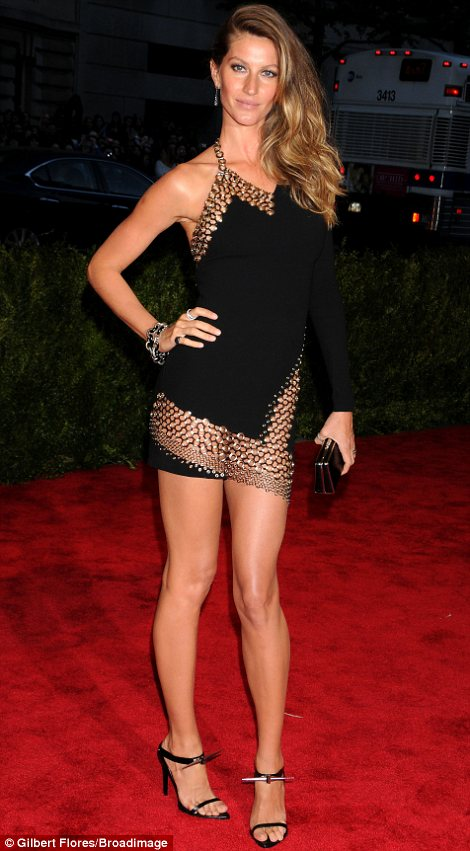 Model mayhem: Gisele (L) and Jessica Hart wisely decided to show off their amazing figures. Gisele was racy in Anthony Vacarello while Jessica sizzled in Diane von Furstenburg