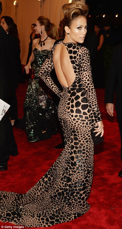 Wild things: Jennifer Lopez (L) and Coco Rocha both decided to show their racy sides in animal print numbers
