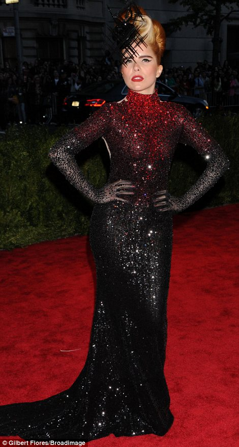Bringing the drama: Paloma Faith wall all about the theatrics in a graduated sequined backless gown, elaborate hairdo and striking fascinator