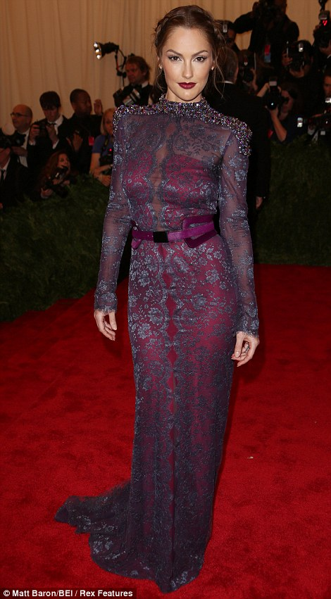 Working the camera: Minka Kelly made sure she showed off her Carolina Herrera gown at every angle
