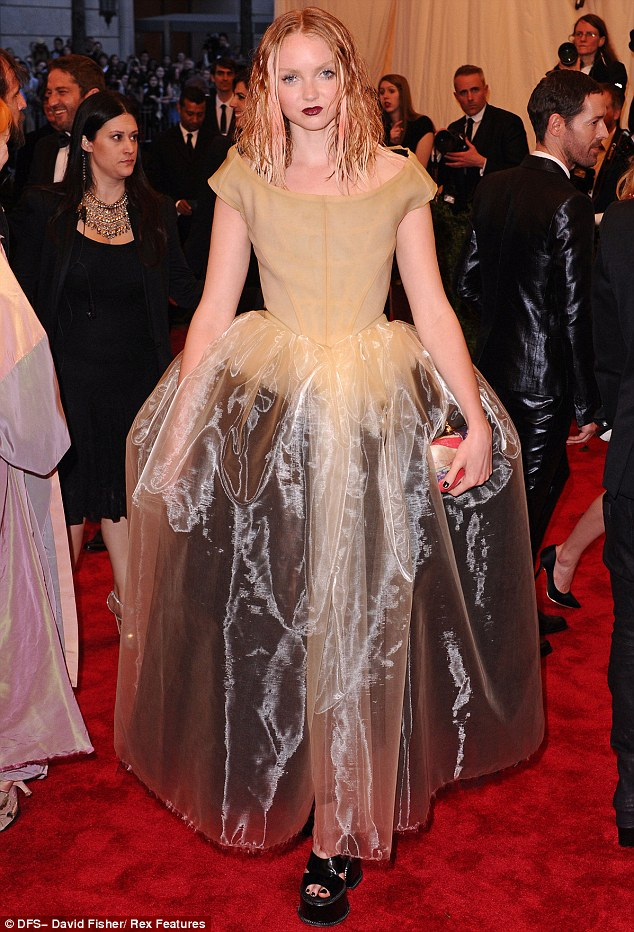 Porcelain doll: Lily Cole slipped into a nude-coloured gown with a full skirt and platform heels