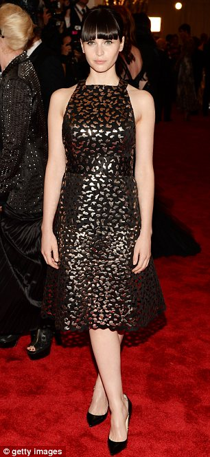 Black is best: Downton star Michelle Dockery wore a snake-print dress with a statement necklace. Felicity Jones wore a black shift dress with liquid gold print