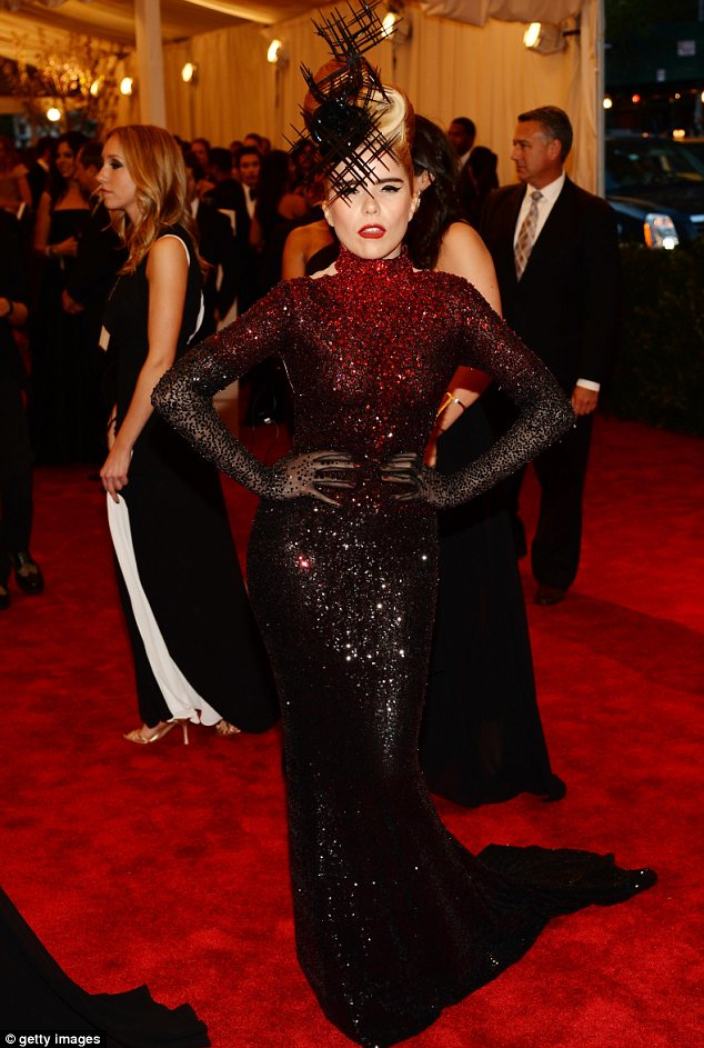 Hat's nice! Paloma Faith wore a glittering red and black outfit with an interesting headpiece