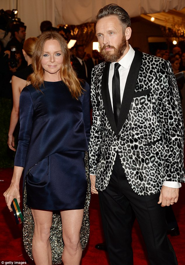 Spot the fashion couple: Stella McCartney and her husband Alasdhair Willis wore eye-catching looks to the event