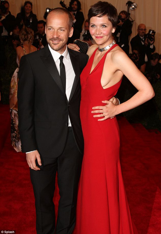Happy: Maggie's husband Peter Sarsgaard look delighted by what was she was wearing