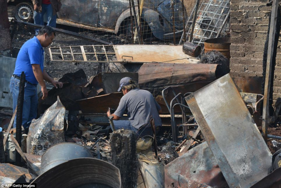 A gas tanker exploded in a Mexico City suburb on Tuesday, killing at least 18 people, wounding 36 others and damaging several homes and cars, an official said