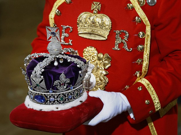 The Imperial State Crown is carried on a cushion as it arrives for the State Opening of Parliament, at the Houses of Parliament in London