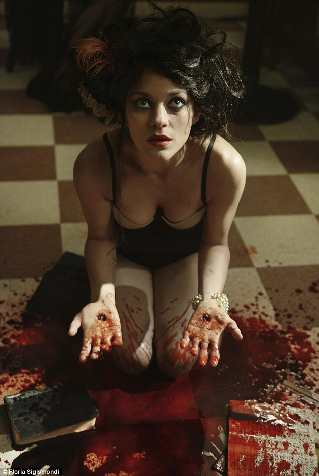 Dramatic scenes: Cotillard drops to the floor as blood splays out of her hands while suffering from a case of stigmata
