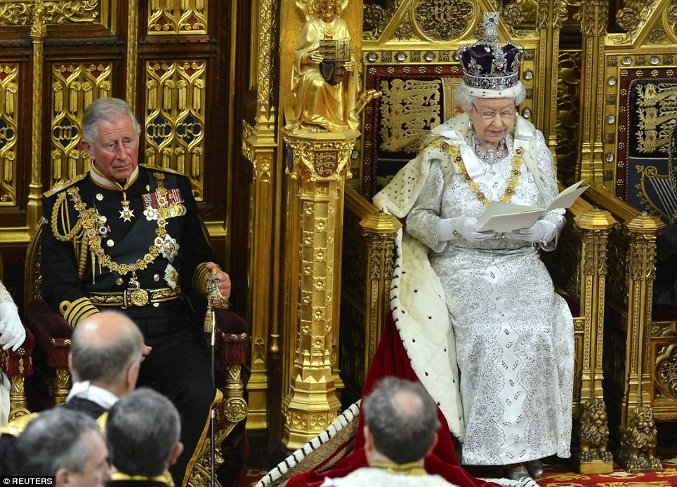 Support: Prince Charles stands next to the Queen in the Lords as she announces 20 bills which her Government hopes to pass in the coming year