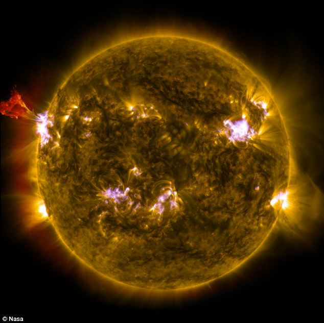 This image combines three images from NASA's Solar Dynamics Observatory captured on May 3