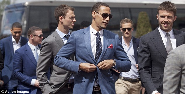 Suits you, Rio: Ferdinand (centre) and his United team-mates arrive at Chester Racecourse for the club's annual race day