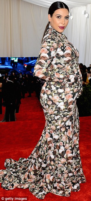 In full bloom: Kim received mixed reviews for the floor length floral Givenchy gown she sported at the Met Ball on Monday night