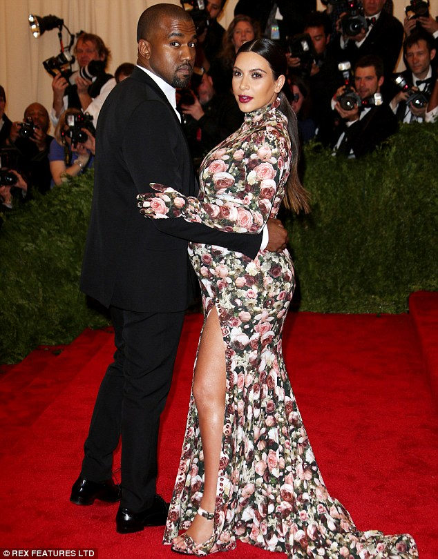 Constantly in touch: Despite spending time apart due to work commitments, Kim and Kanye talk to each other '100 times a day' said a friend