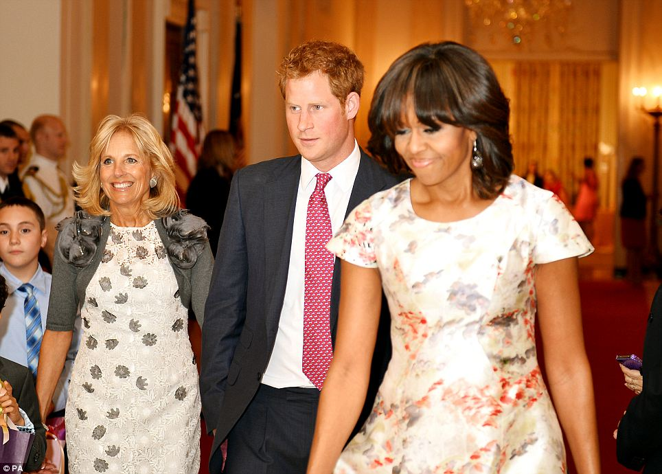 Royal welcome: Prince Harry and Michelle Obama were joined by Jill Biden, the vice president's wife