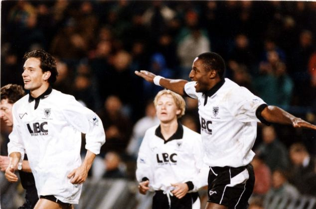 Star: Fashanu celebrates a goal with his Wimbledon teammates in 1993