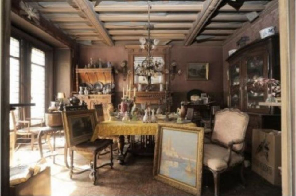 Under a thick layer of dusk lay a treasure trove of turn-of-the-century objects including a painting by the 19th century Italian artist Giovanni Boldini