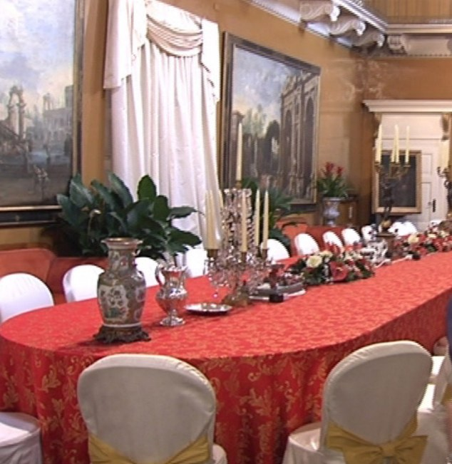 The dining room at Berlusconi's ostentatious villa, where he regularly entertained TV showgirls and wannabe starlets