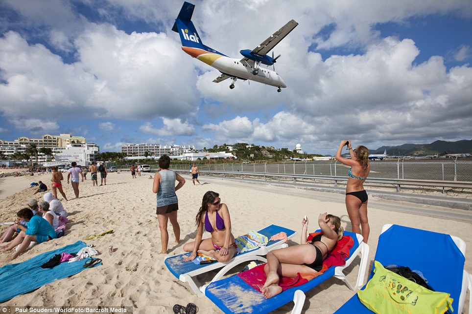 Noisy neighbour: An Air France jet comes in to land over tourists on Maho Beach which is situated a few yards from Princess Juliana International Airport