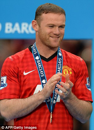 All smiles: But will Rooney remain at United after demanding a transfer away from the club?
