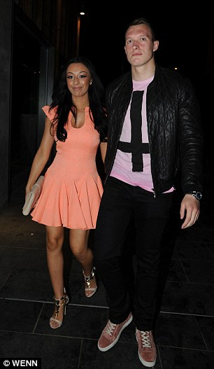 Two's company: Defender Phil Jones and girlfriend Kaya Hall celebrated his first Premier League win