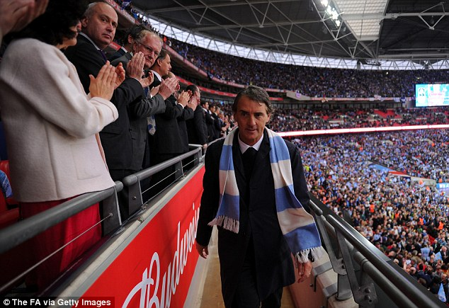 The last walk: Mancini walks to collect his runners-up medal after the FA Cup final defeat to Wigan