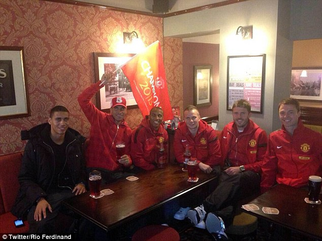 Party time: Rio Ferdinand tweeted this picture of him and his team-mates in a pub