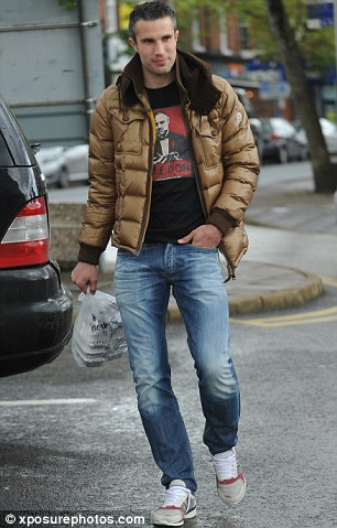 Star striker: Robin van Persie takes a stroll in Alderley Edge before the title parade