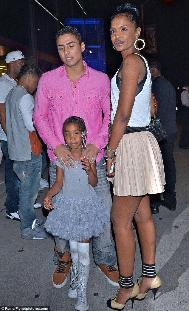 Tight-knit: Kim with her eldest son Quincy and one of her twins