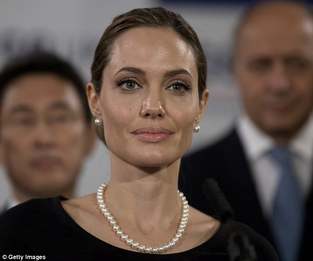 A lot going on: Angelina was still in the midst of her procedures when she attended the Foreign Ministers G8 meeting in Lancaster House on April 11 in London, England