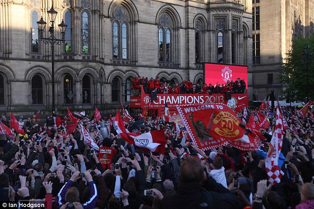 Delight: The team arrived at Albert Square at around 8pm where the parade concluded
