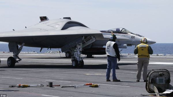 U.S. Navy's X-47B 'stealth drone' launches from an ...