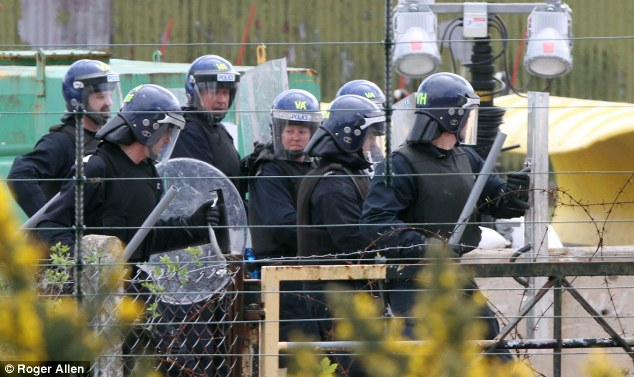 Practice makes perfect: The picture shows a group of Met police during the training drill which saw officers banging batons on plastic shields