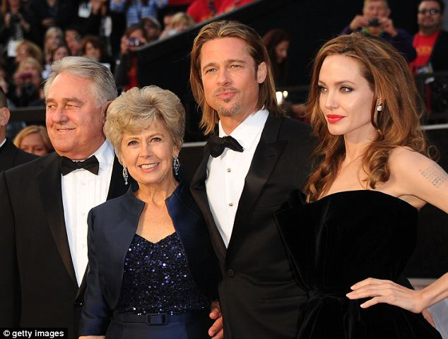 Family values: Brad and Angelina with Brad's father, William Pitt (far left), and mother Jane Pitt (second left). It was thanks to Brad¿s healthcare activist mother that Angelina was tested for the BRCA1 gene at all