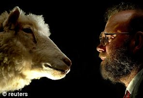 Dr Ian Wilmut, leader of the team that created Dolly the sheep - the world's first mammal cloned from an adult cell - faces her
